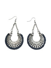 Long blue crescent-shaped statement earrings