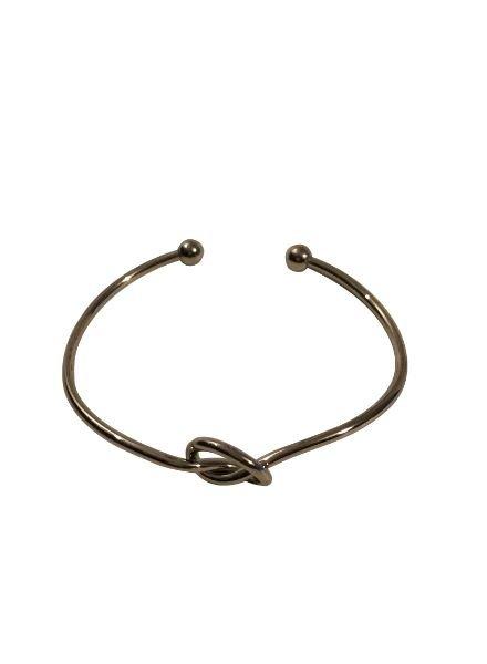 Silver colored minimalistic chic statement cuff bracelet knot
