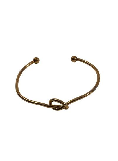 Gold colored minimalistic chic statement cuff bracelet knot