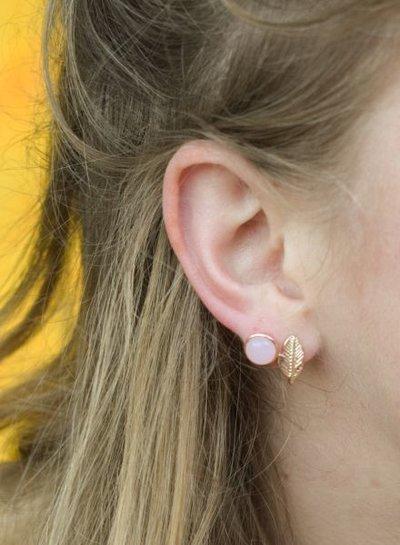 Minimalistische statement oorbellen rond rosé goudkleurig