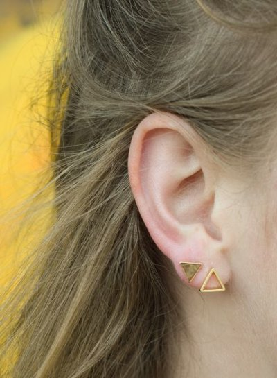 Minimalistic statement earrings open triangles silver colored