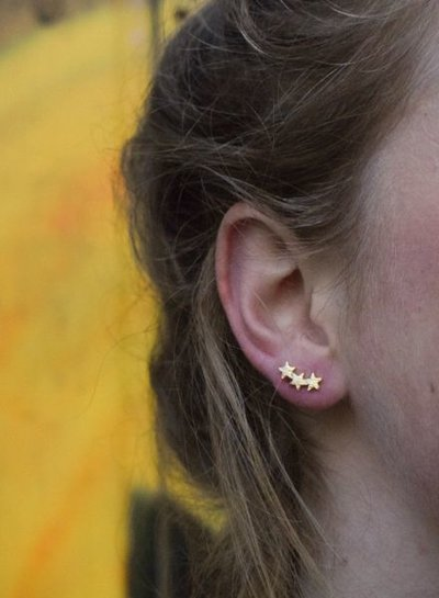 Cool minimalistic statement earrings stars rose gold colored