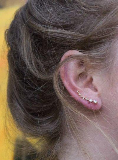 Coole minimalistische statement oorbellen met strass goudkleurig