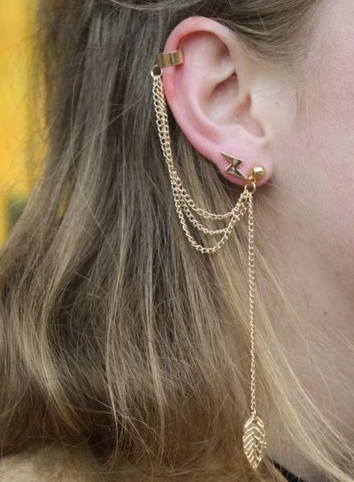 Long, edgy statement earring with feather silver colored