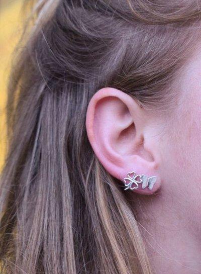Minimalistische statement oorbellen vlinder rosé goudkleurig