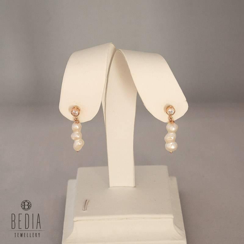 Triple pearl oorbellen