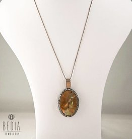 Necklace with a brown colored pendant