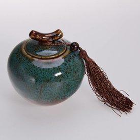 grüne Teedose aus Porzellan