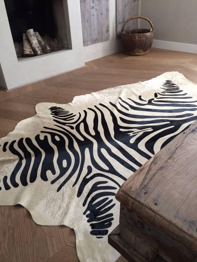 koeienhuid met zebra print stoer en robuust wonen