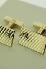 14 carat gold cufflinks with small single cut diamond