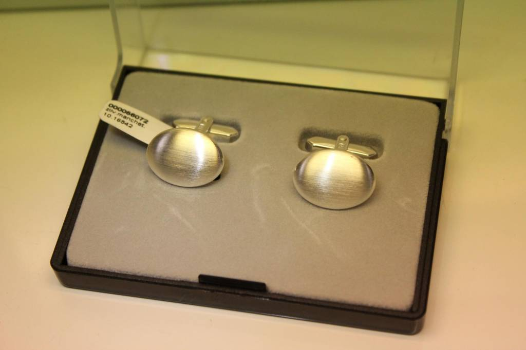 Silver cufflinks oval shaped matted and curved