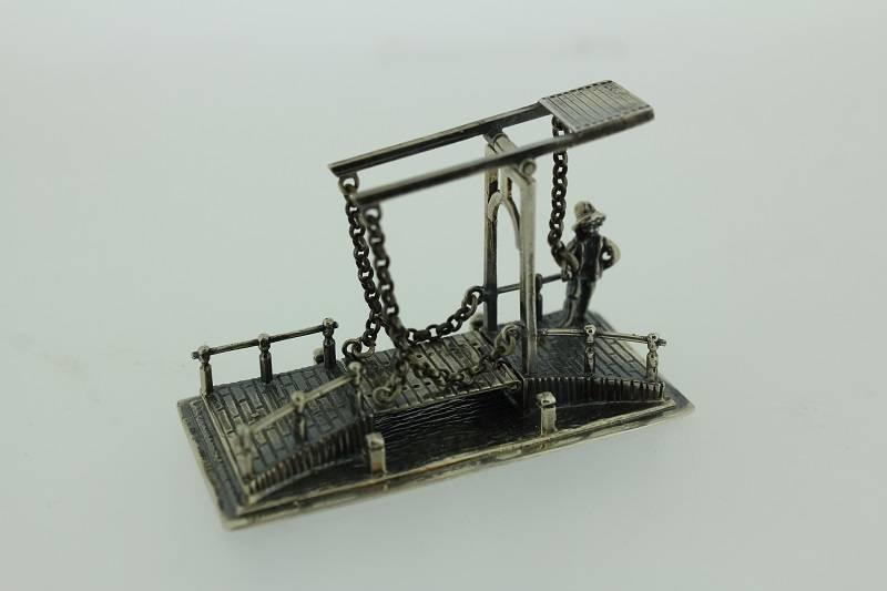 Silver drawbridge with guard miniature
