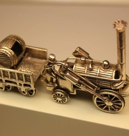 Miniature silver locomotive with coal wagon