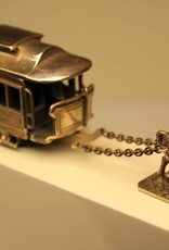 Silver miniature of a tram, pulled by a horse