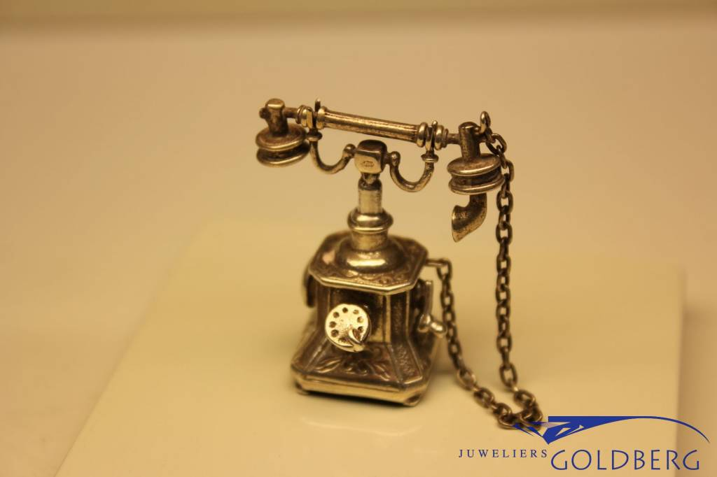 Silver antique phone miniature