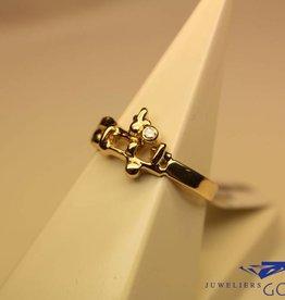 14 carat gold design ring with 0.03ct diamond