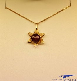 18 carat gold pendant with ruby