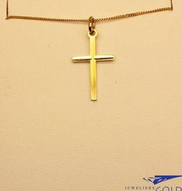 Delicate 14 carat gold cross pendant