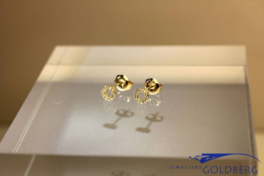14 carat gold circle design earrings with diamonds