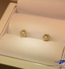 14 carat gold circle design earrings with diamonds