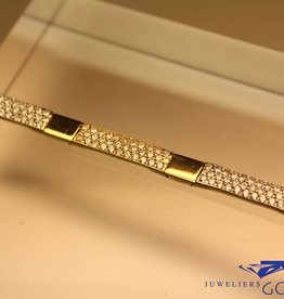 14 carat gold bracelet pave set with zirconia's