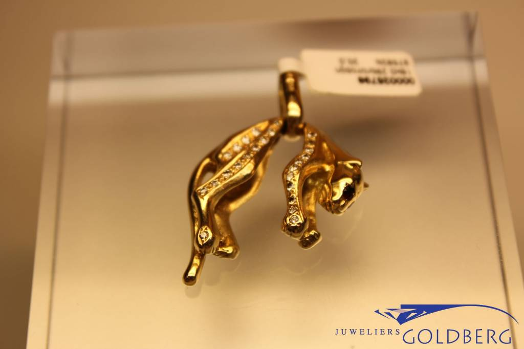 Vintage 18 carat gold panther pendant with diamond and ruby