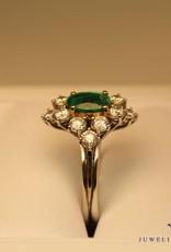 white gold ring oval cut emerald and brilliant cut diamonds