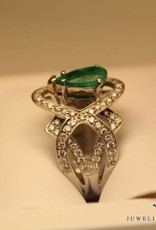 white gold ring with 2.30ct pear cut emerald and diamonds