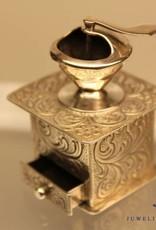 silver miniature coffe grinder