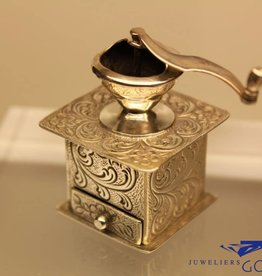 silver miniature coffe grinder
