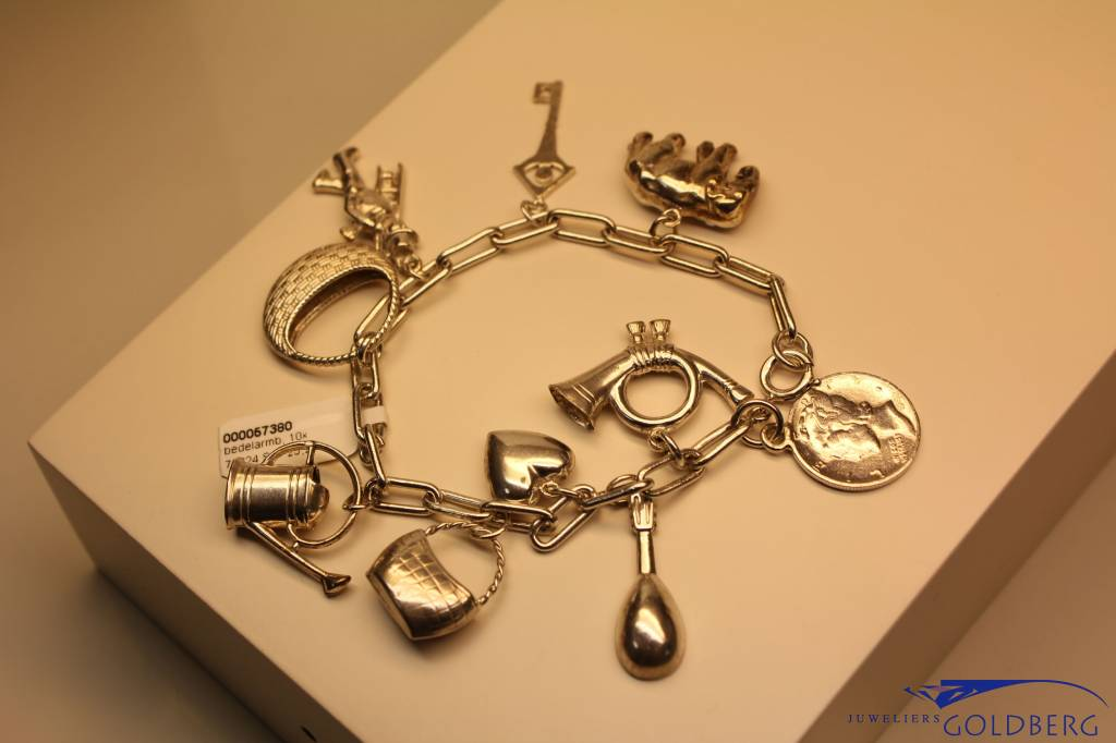 Silver charm bracelet with 10 charms
