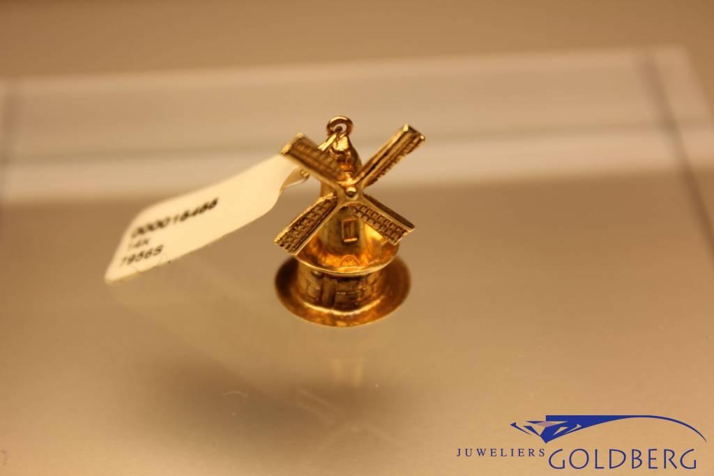14 carat gold windmill pendant