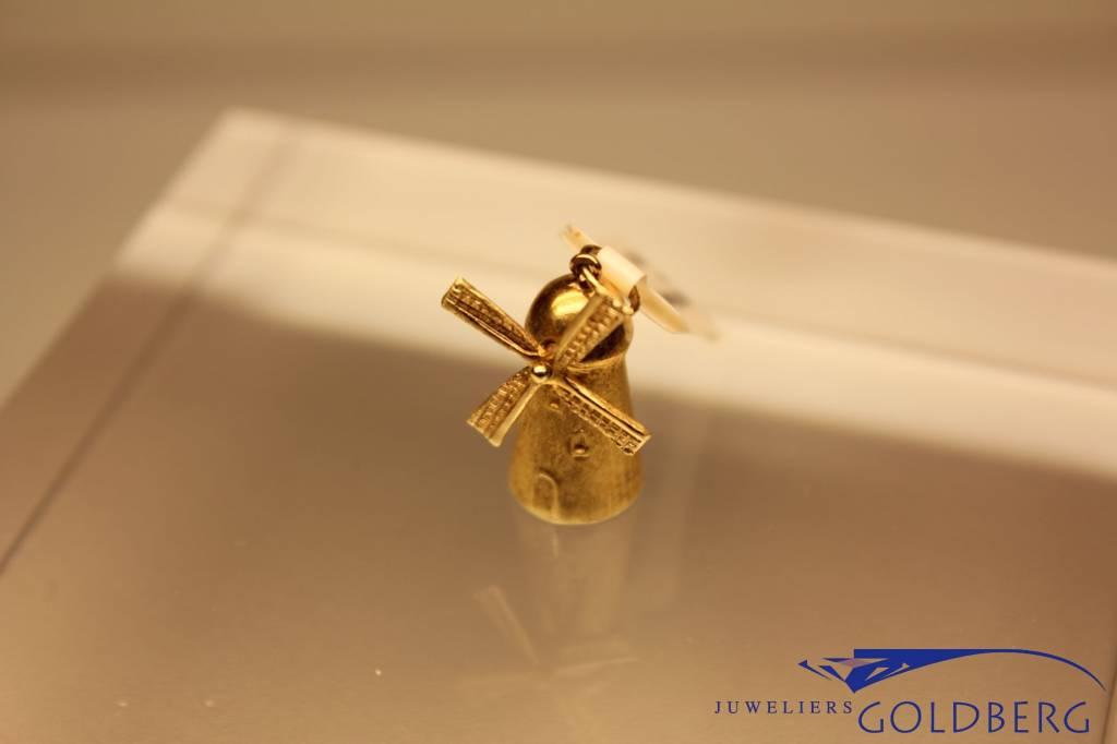 14 carat gold windmill pendant wide