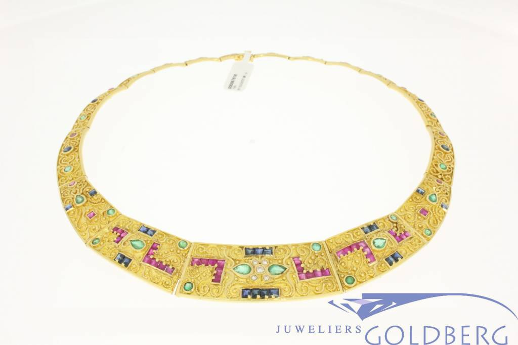 gold necklace, with rubies, sapphires, emeralds and diamonds.