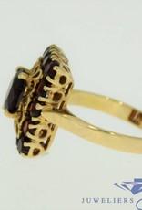 vintage 18k gold ring with 1 big garnet and 14 little garnet