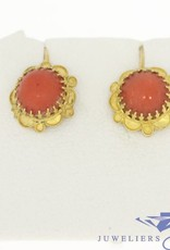 Vintage 14 carat gold earring with red coral in flower-shaped ornament