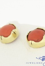 Vintage 14 carat gold earstuds with large light red coral