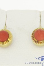 Vintage 14 carat gold circular earring with blood coral