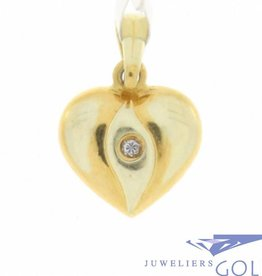 Delicate vintage 14 carat gold edited heart pendant with zirconia