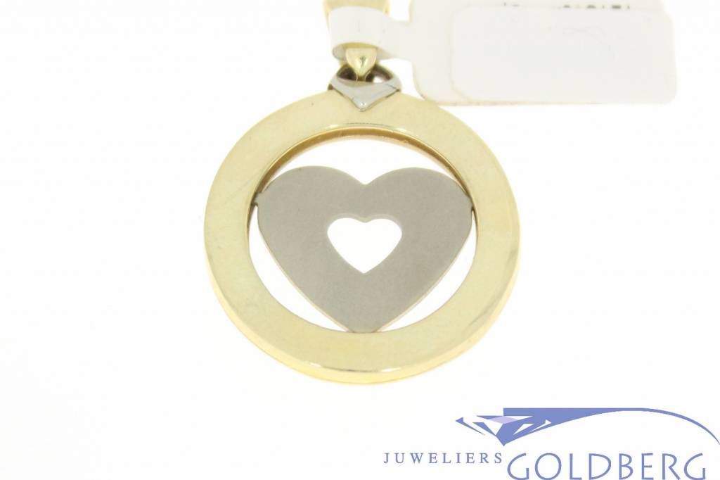 Large vintage 14 carat bicolor gold round pendant with heart and zodiac signs