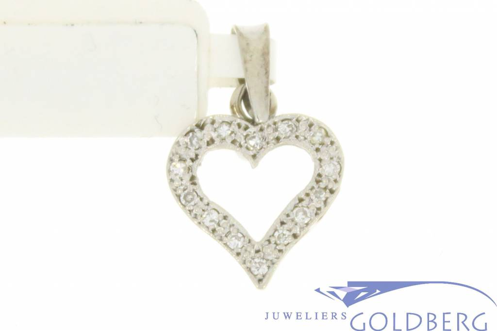 Vintage 14 carat white gold heart-shaped pendant with diamonds