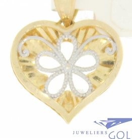 Vintage 14 carat gold open heart-shaped pendant with flower adornment
