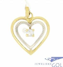 Vintage 18 carat bicolor open heart-shaped pendant with ca. 0.10 brilliant cut diamond