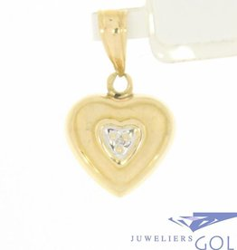 Vintage 14 carat gold heart pendant with ca.0.005ct diamond