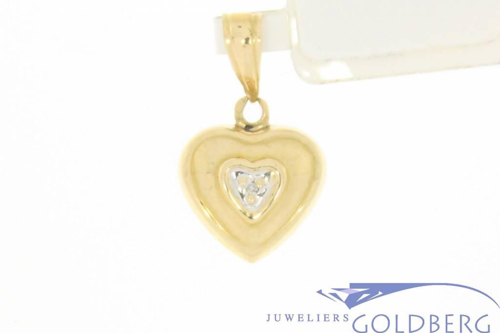 Vintage 14 carat gold heart pendant with ca.0.005ct diamond