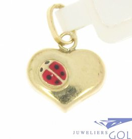 Cute vintage 14 carat gold heart pendant with ladybug