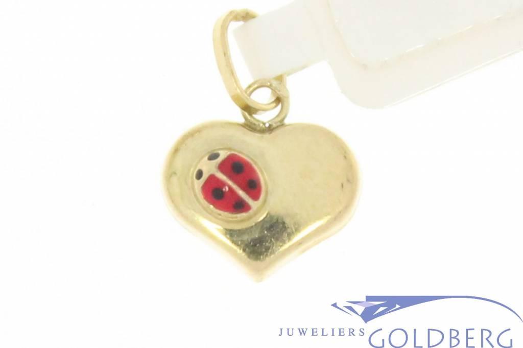 Cute vintage 14 carat gold heart pendant with ladybug