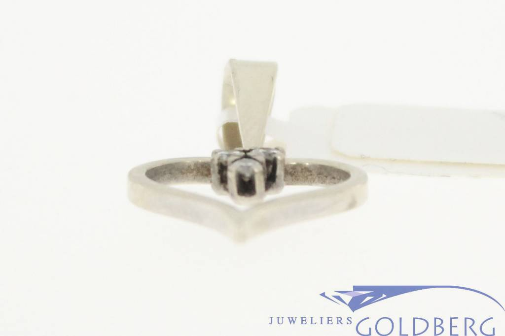 Vintage 18 carat white gold open heart-shaped pendant with approx. 0.10ct brilliant cut diamond