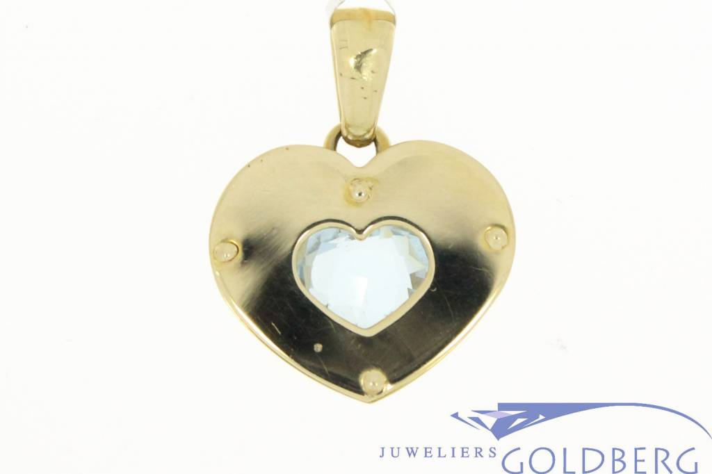 Large vintage 14 carat gold heart-shaped pendant with faceted aquamarine