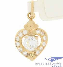 Delicate vintage 14 carat gold heart pendant with zirconia